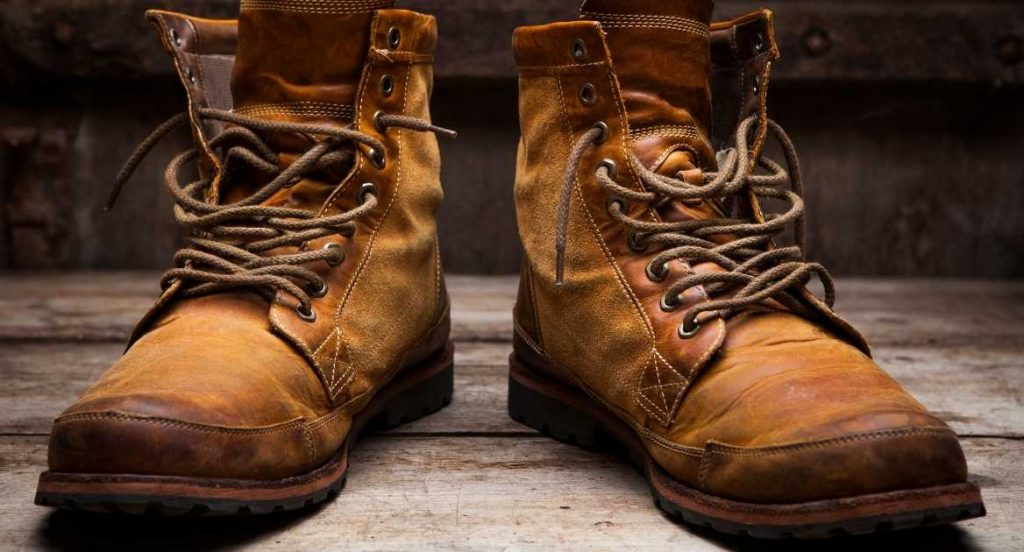 why do logger boots have high heels